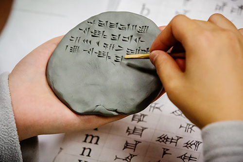 Cuneiform symbols on a clay tablet