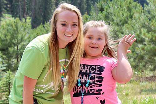 Heather Holmes poses with a camper during her time working work at a Missouri camp for people with special needs
