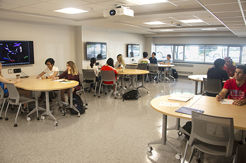 Students at tables in the MCB Learning Center