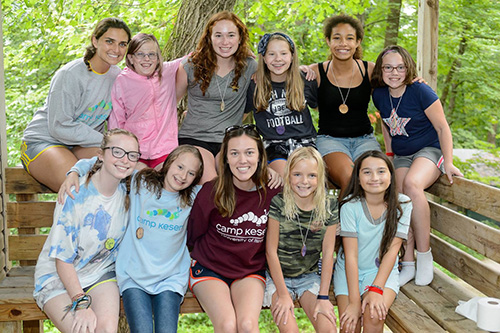 Maggie posts with campers at Camp Kesem