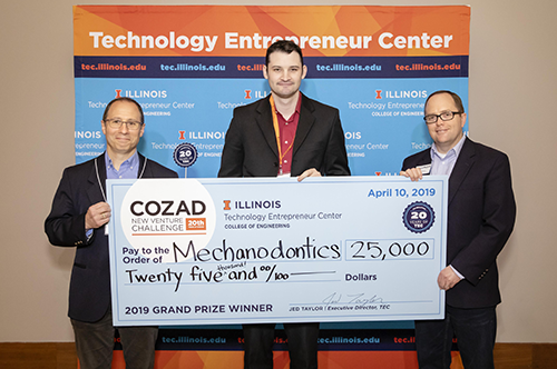 Mechanodontics receives award check from TEC