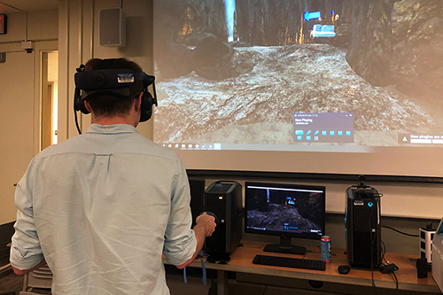 Student enters a cave using virtual reality device