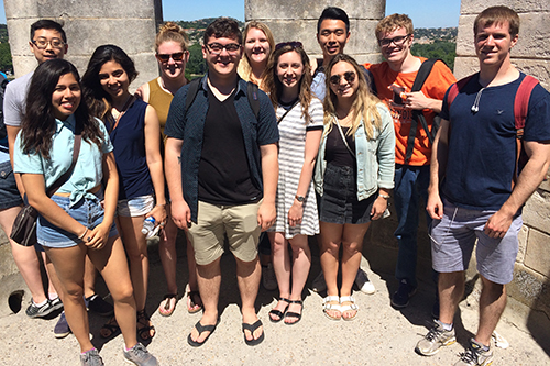 Students pose in Arles, France