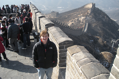 A student poses at the Great Wall of China