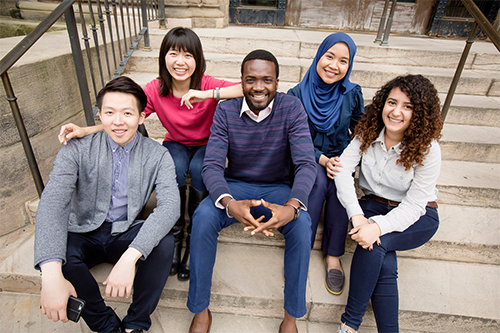 A group of international students on the steps of Foellinger Auditorium
