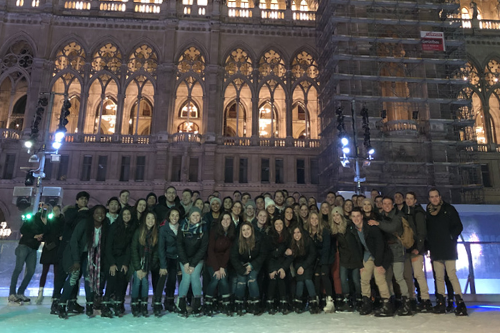 A group of students pose in front of a cathedral in Vienna