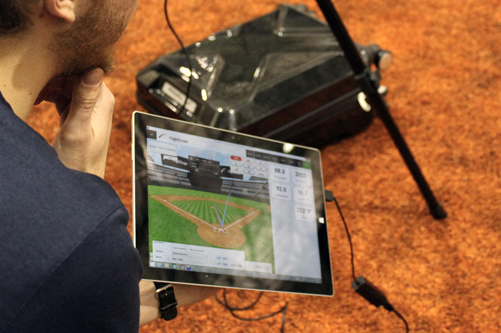 Charlie Young collects and analyzes FlightScope data. (Image courtesy of CS @ Illinois.)