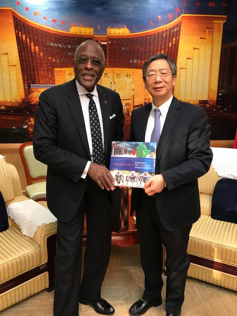 Yi Gang, right, has been appointed the next governor of the People's Bank of China. He is shown here with University of Illinois at Urbana-Champaign Chancellor Robert Jones, in November 2017.