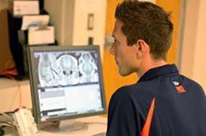 Austin Mudd, whose study linked choline and fetal brain development, works with an MRI image. (Image courtesy of the College of ACES.)