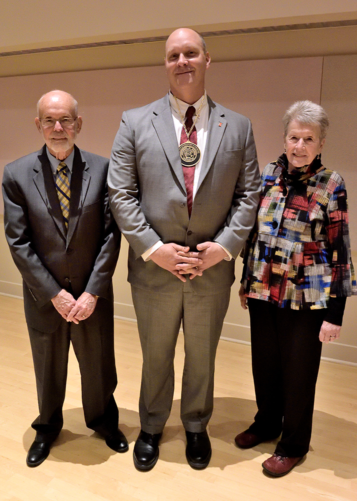 Chad Rienstra, center, has been named the John Witt Professor of Chemistry. John Witt and his wife, Margaret, posed with Rienstra for a photo at the ceremony. (Photo by Lou McClellan.)