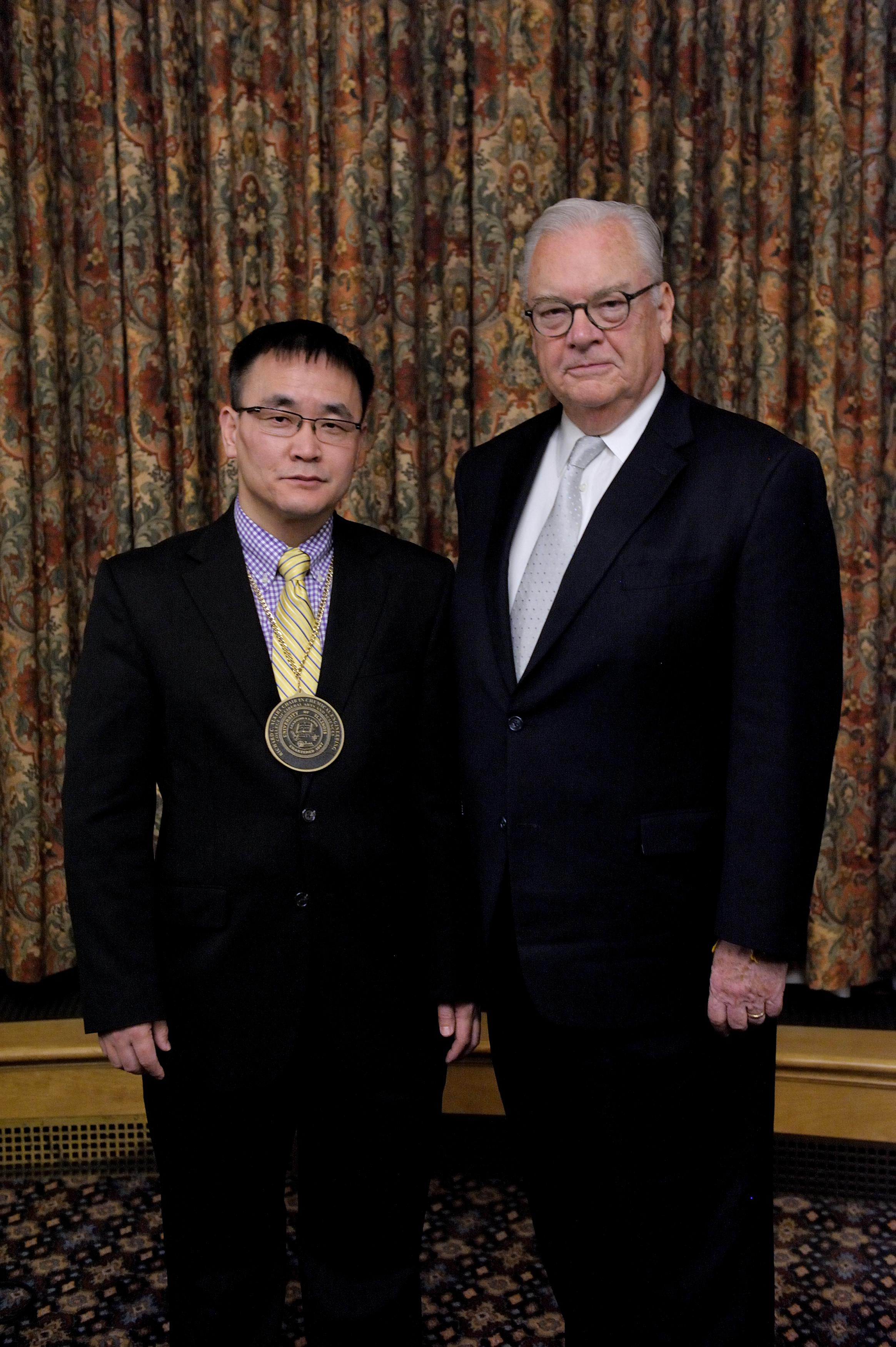 Hong Yang, left, and Richard Alkire pose for a photo after Yang was formally named the Richard C. Alkire Chair in Chemical Engineering. (Thompson-McClellan.)
