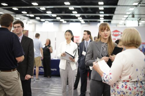 Students talk to recruiters at the ACES + LAS Career Fair