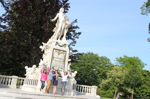 Students pose with a statue of Mozart in Vienna