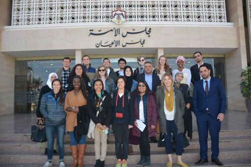 A group of students and faculty members on a study abroad trip to Jordan
