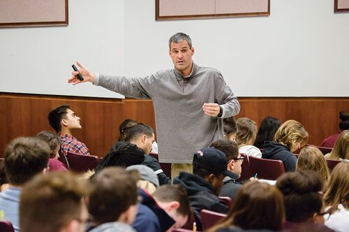 Communication professor Brian Quick lectures students