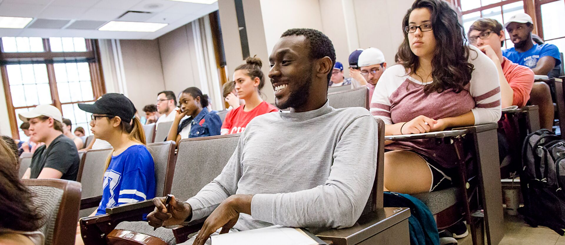 Smiling students sitting in a lecture class