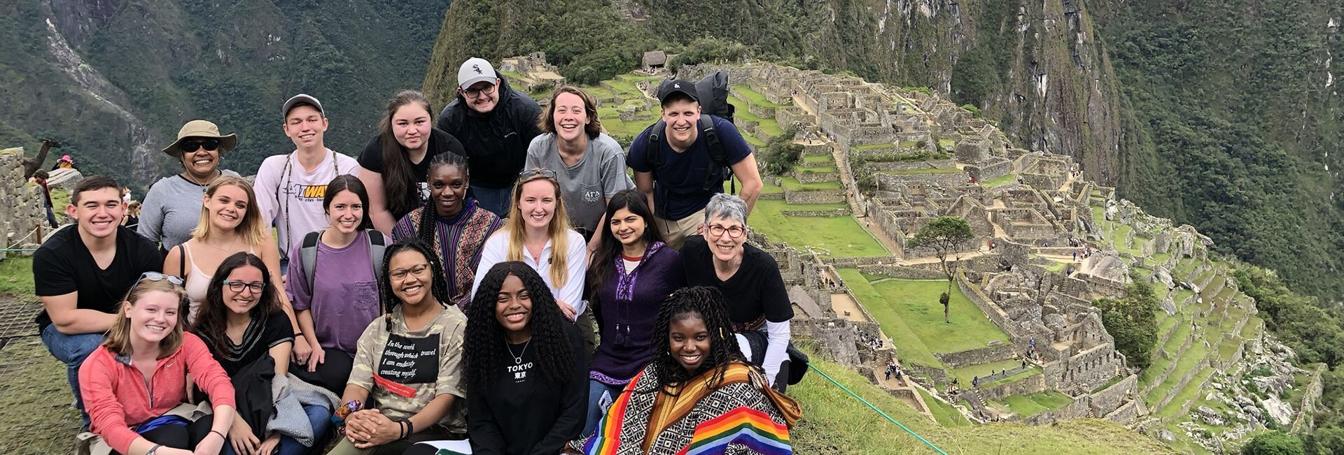 Students post at the top of Machu Picchu, Peru.