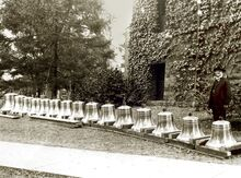 University president Edmund Janes James (1855–1925) poses next to the soon-to-be-installed chime bells
