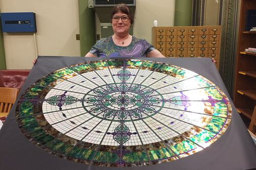 Jane Bergman and her replica of Altgeld Hall's former glass dome