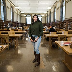 Edith Munoz poses in the Main Library at the University of Illinois