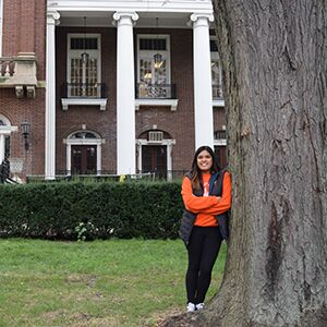 Megan Resurreccion poses in front of the English Building