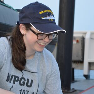 Recent LAS graduate Bridget Mueller-Brennan smiles while working for the National Marine Fisheries Service