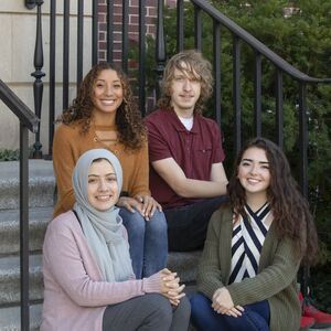 Jason Smith (back right) poses with other students from the Department of History, including Yasmeen Ragab, Johnna Jones, and Carmen Gutierrez.