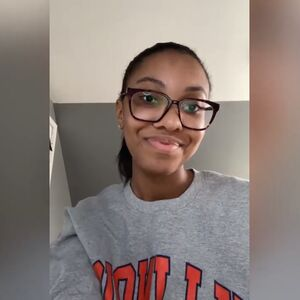 LAS student records video in a gray Illinois sweathshirt